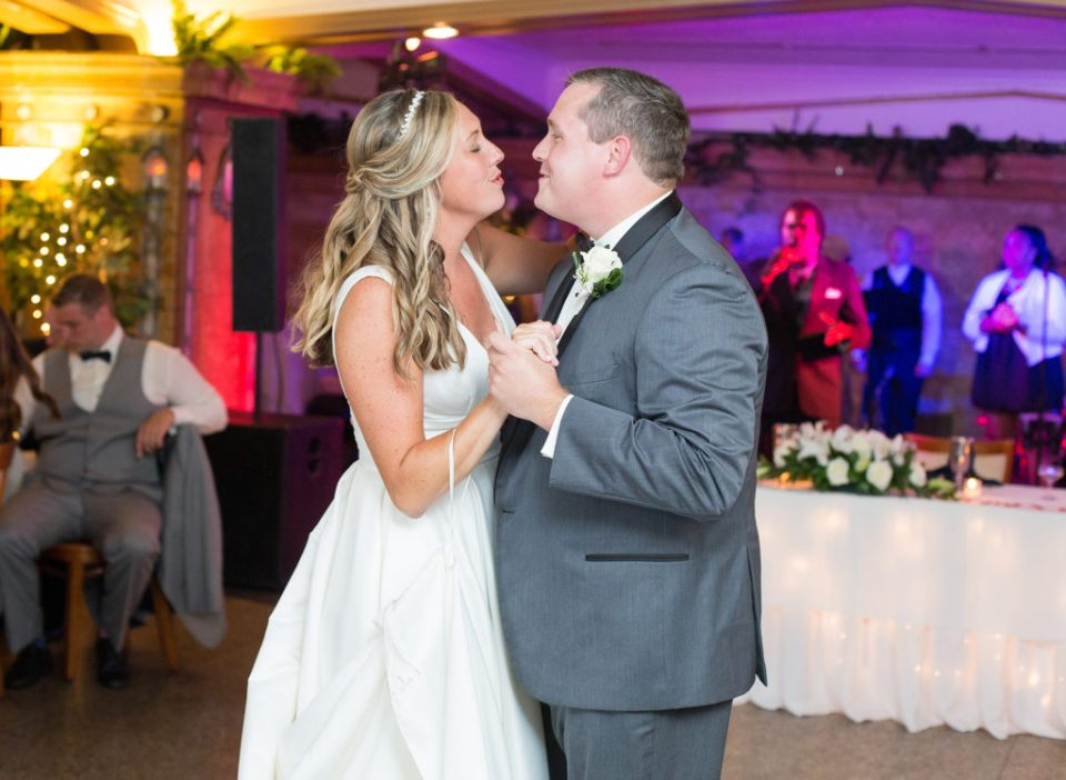 Erie PA bride and groom sing to each other during first dance at Masonic Temple wedding reception
