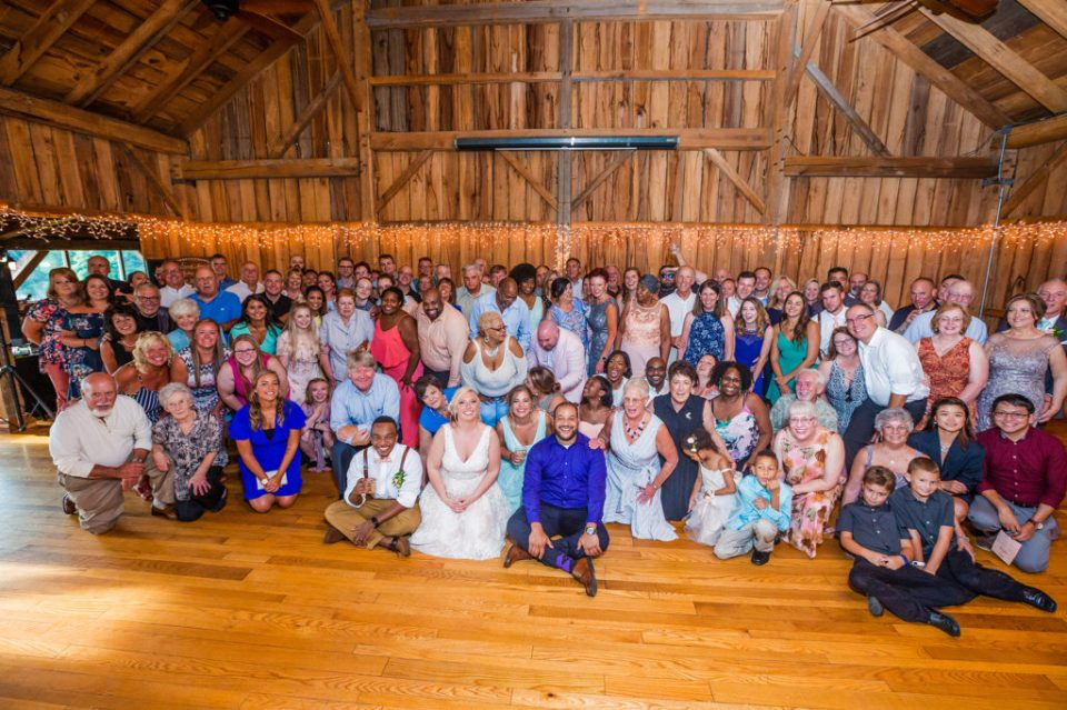 all guests and bridal party gathered for a photo at Betsy's Barn wedding