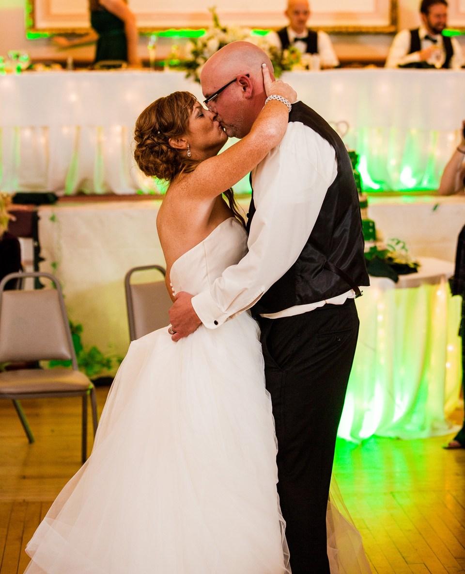 bride and groom kiss on the dance floor of Erie PA Masonic Temple Grand Ballroom