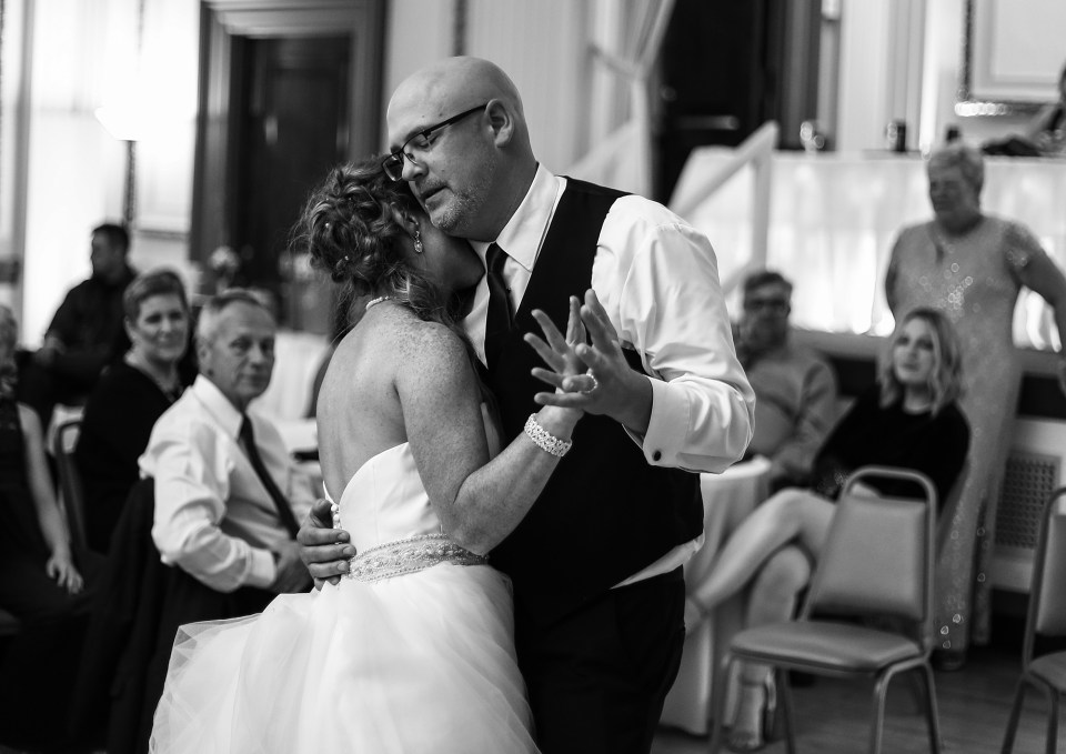 bride and groom share first dance at Erie PA Masonic Temple wedding reception