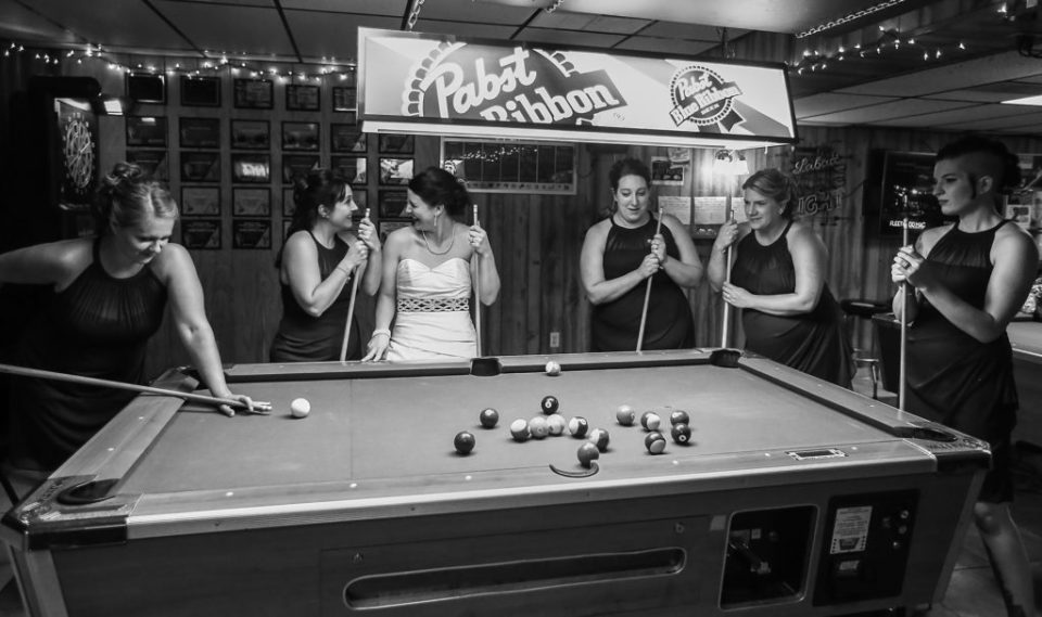 Iconic Black and White Bridal Portrait of the brides maids reenacting the famous rat pack playing pool at Justin and Amandas Warner Theater Wedding