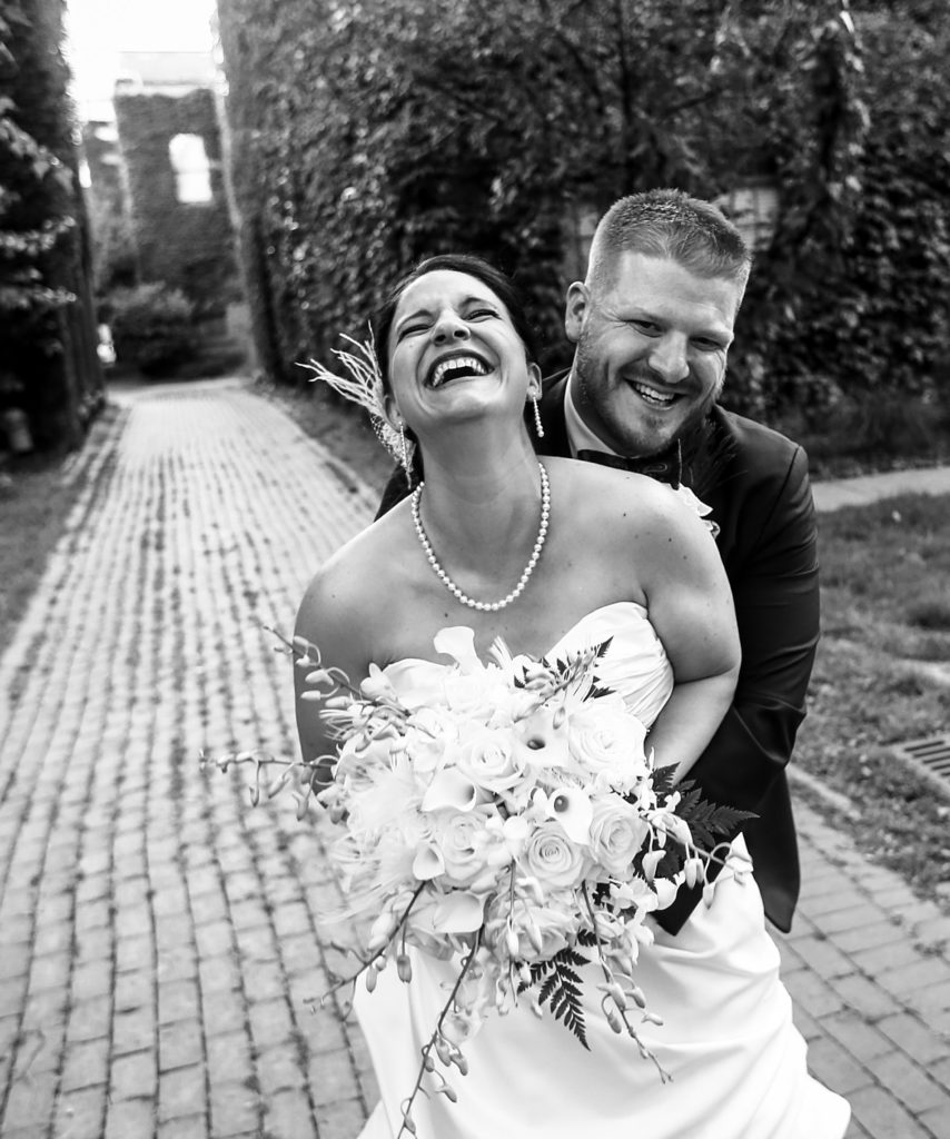 Iconic Black and White Bridal Portrait of the bride and groom laughing at Justin and Amandas Warner Theater Wedding