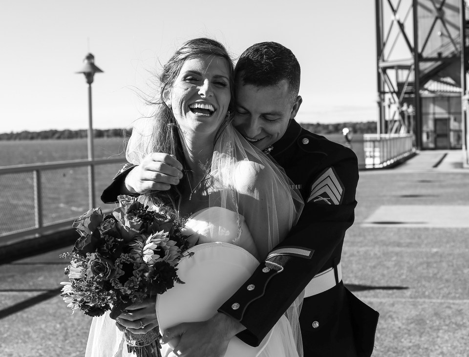 Groom embraces bride during bridal portraits at Bicentennial Tower in Erie, PA