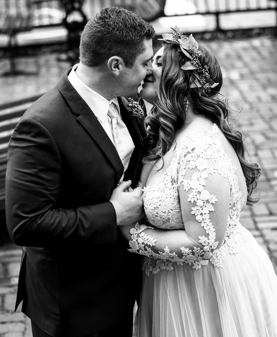 Bride and groom about to kiss outside the Waterford Hotel