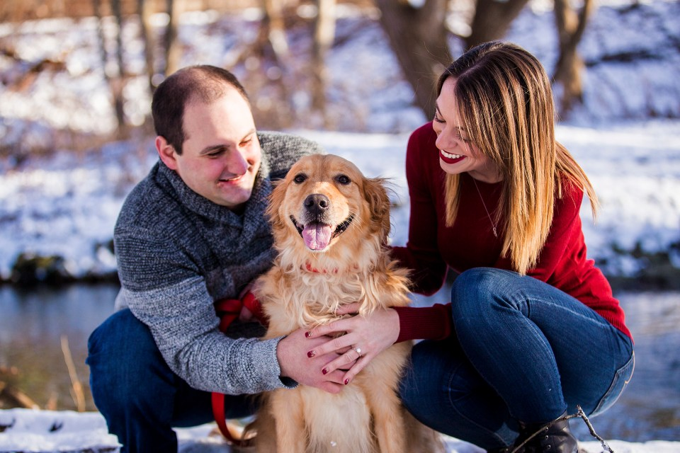 Couple plays with their dog during Frontier Park engagement photos