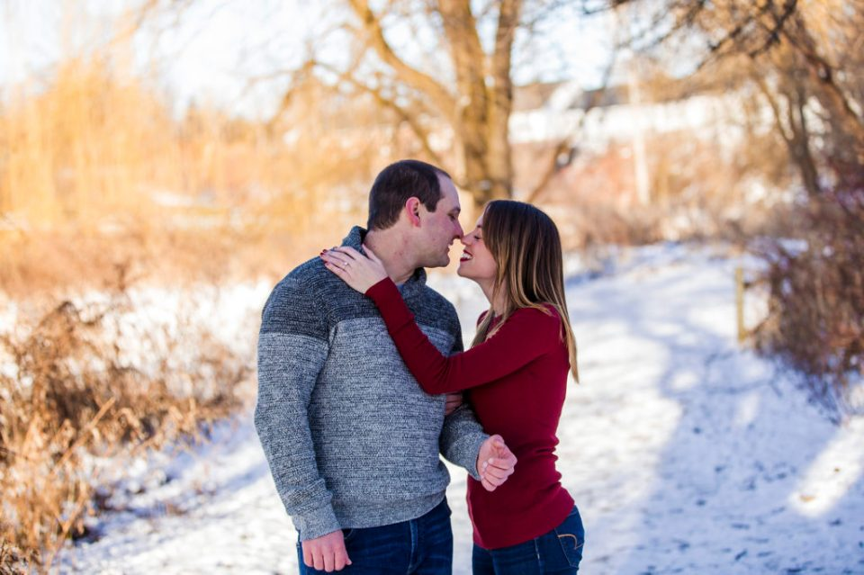 Engaged couple touch noses during Frontier Park engagement photo shoot in Erie PA