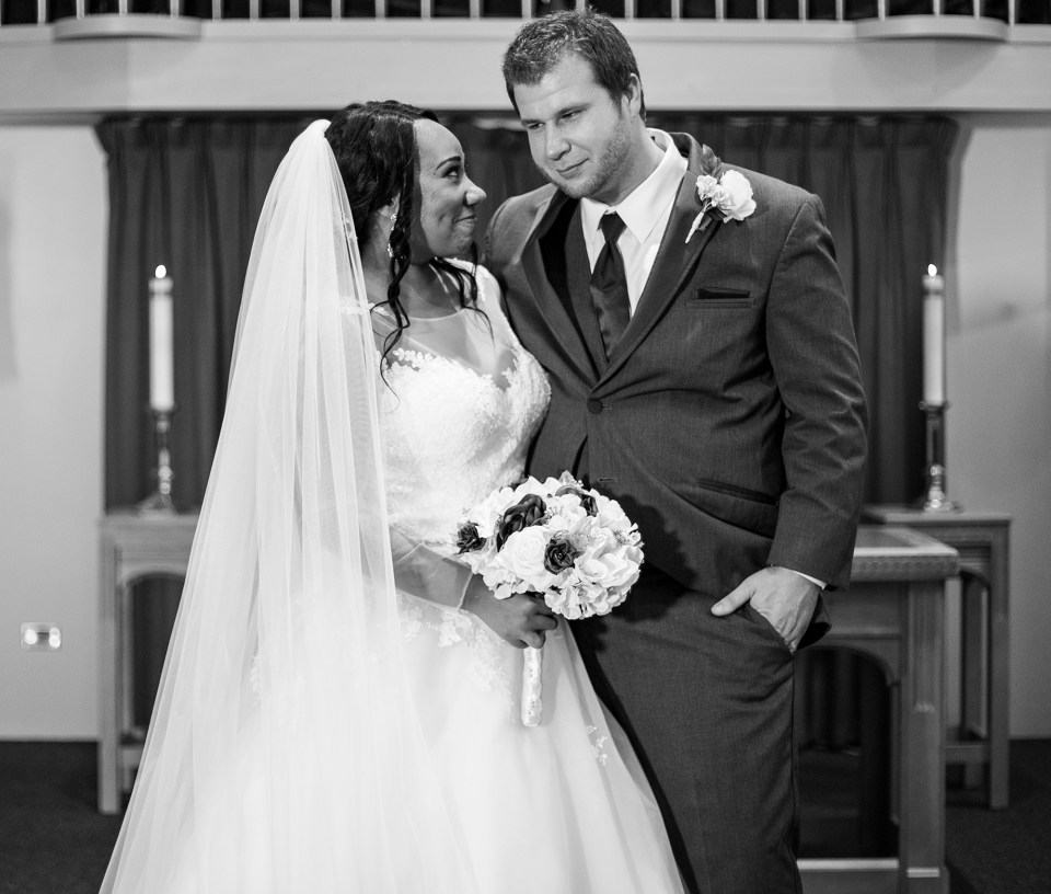 Pittsburgh, PA bride and groom pose for a photo at Bellevue Christian Church wedding