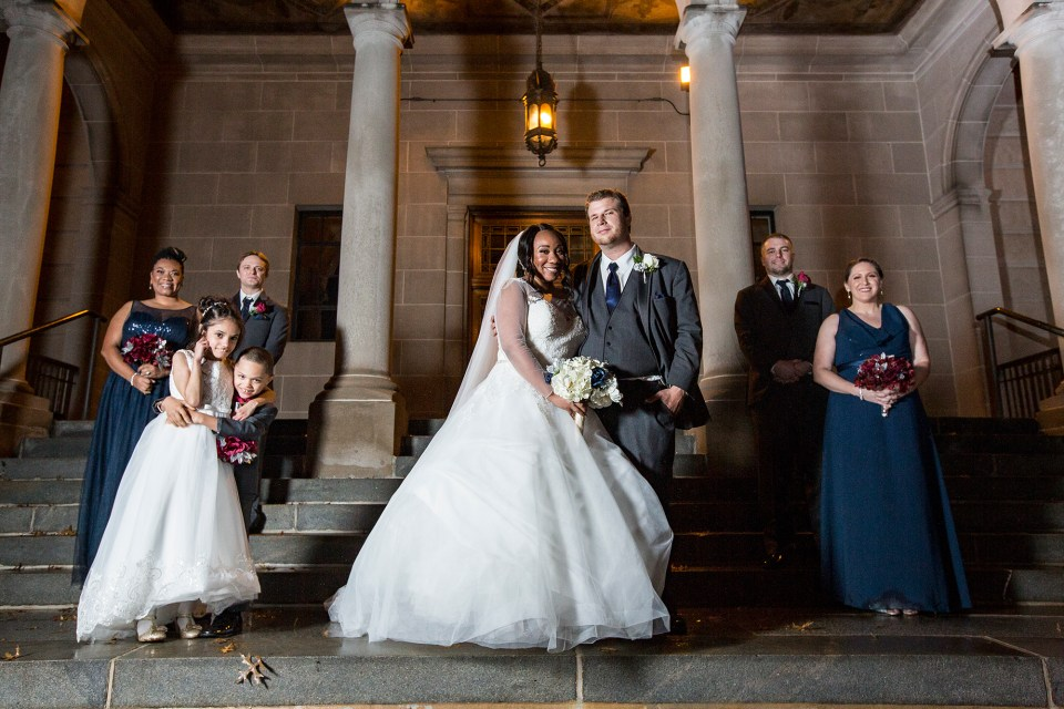 Bridal party poses outside the Laughlin Memorial Library in Ambridge, PA