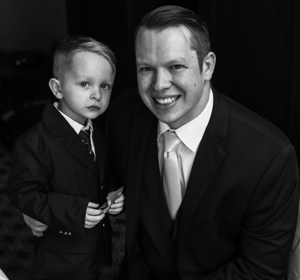 Groom poses with son before Presque Isle beach wedding