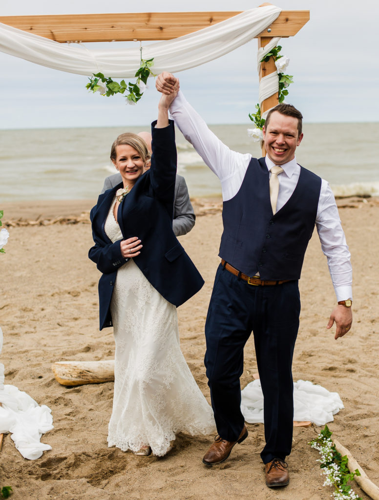 Bride and groom at the end of their Presque Isle beach wedding ceremony