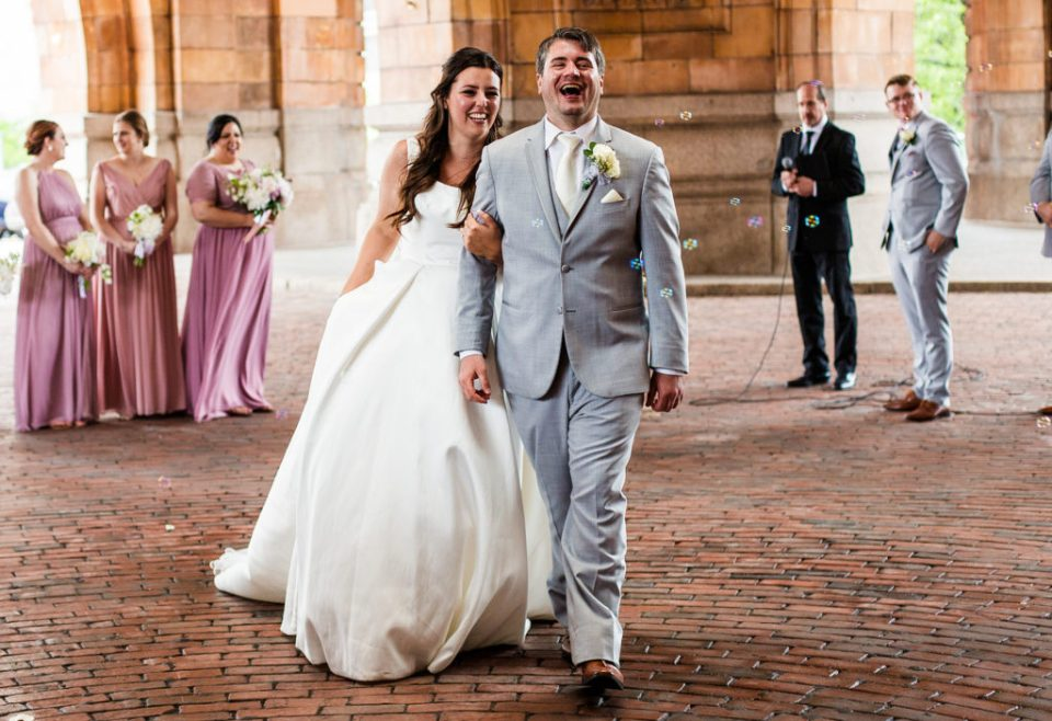 Recessional shot of bride and groom during their Pittsburgh wedding at the Pennsylvanian Apartments