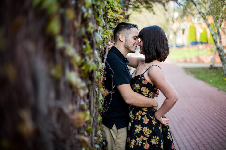 Couple about to kiss during spring engagement photos at Modern Tool Square