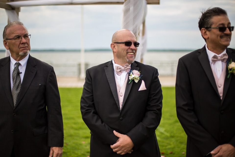 Groom smiles when he sees his bride during spring vow renewal in Erie, PA