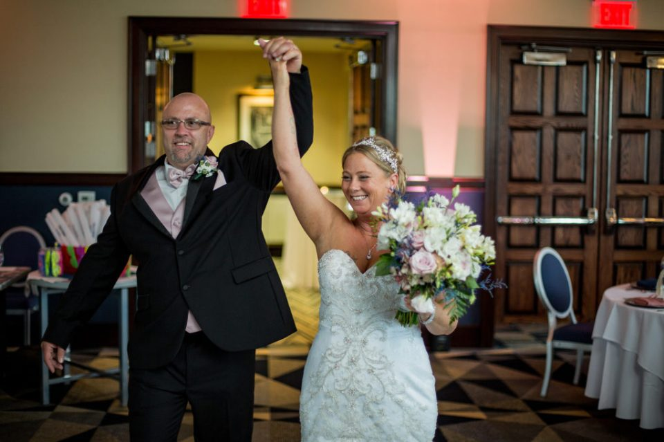 Bride and groom enter reception at Sheraton Bayfront Hotel