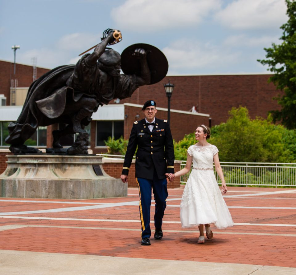 Bride and groom walking campus at wedding at Edinboro University
