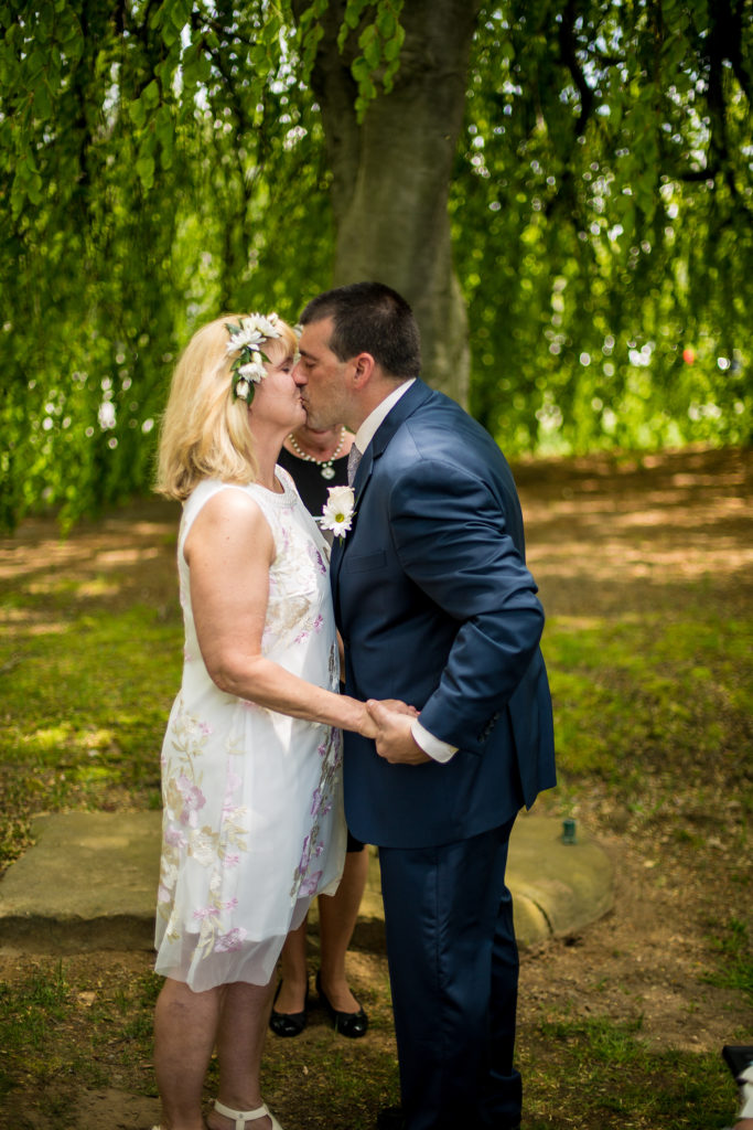 Bride and groom share first kiss at a wedding at the Schoolhouse