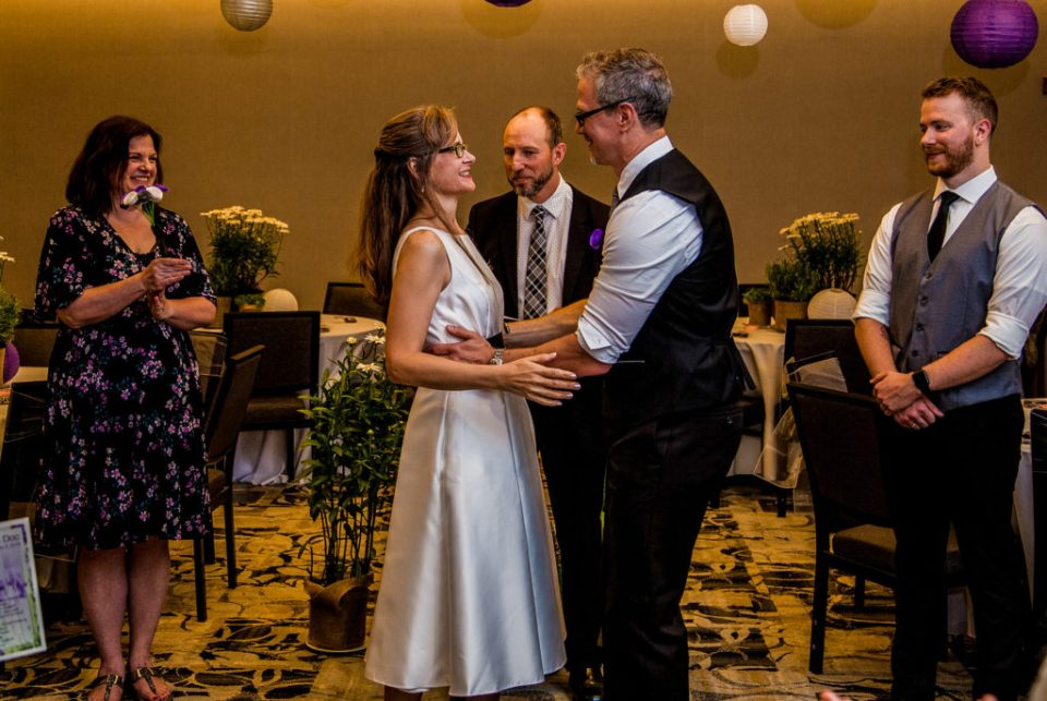Bride and groom embrace at their Courtyard Marriott wedding