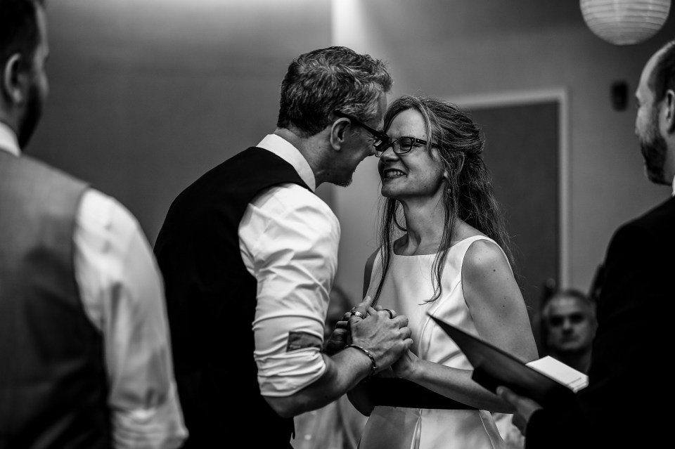 Bride and groom smile at each other during Courtyard Marriott
