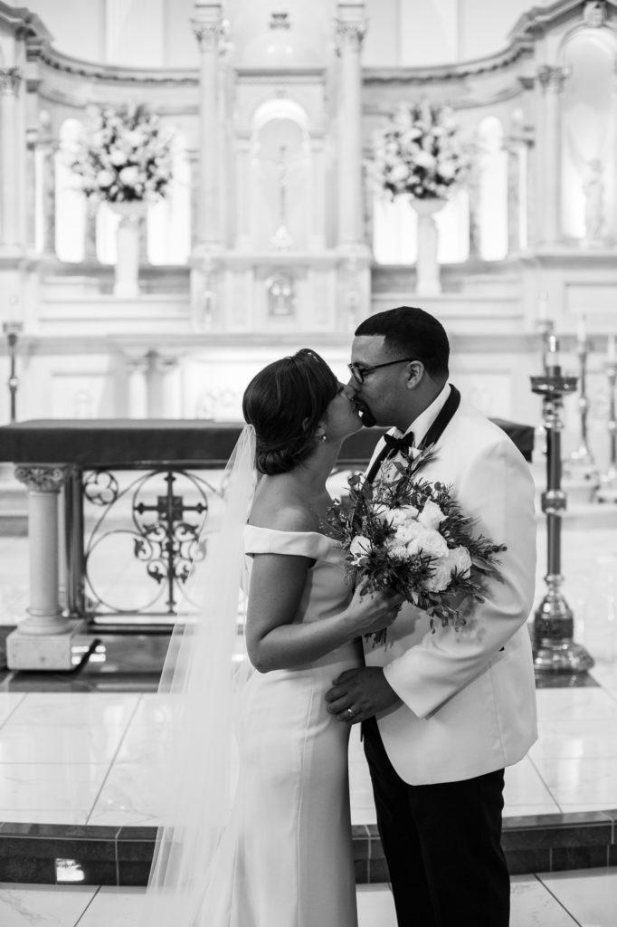 Bride and groom kiss at St. Patrick's Church