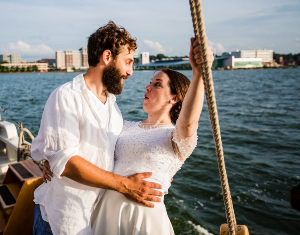 Bride and groom goofing around at their tall ship wedding on the Lettie G Howard