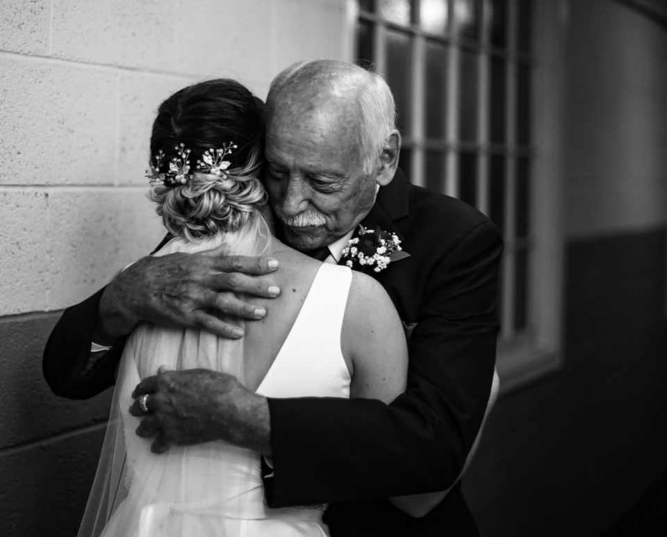 Father embraces bride at Emmanuel Presbyterian Church