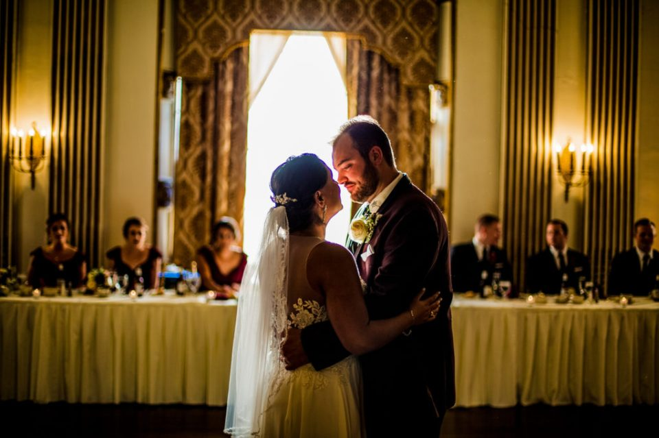 Couple framed by sunlight during first dance at George Washington Hotel