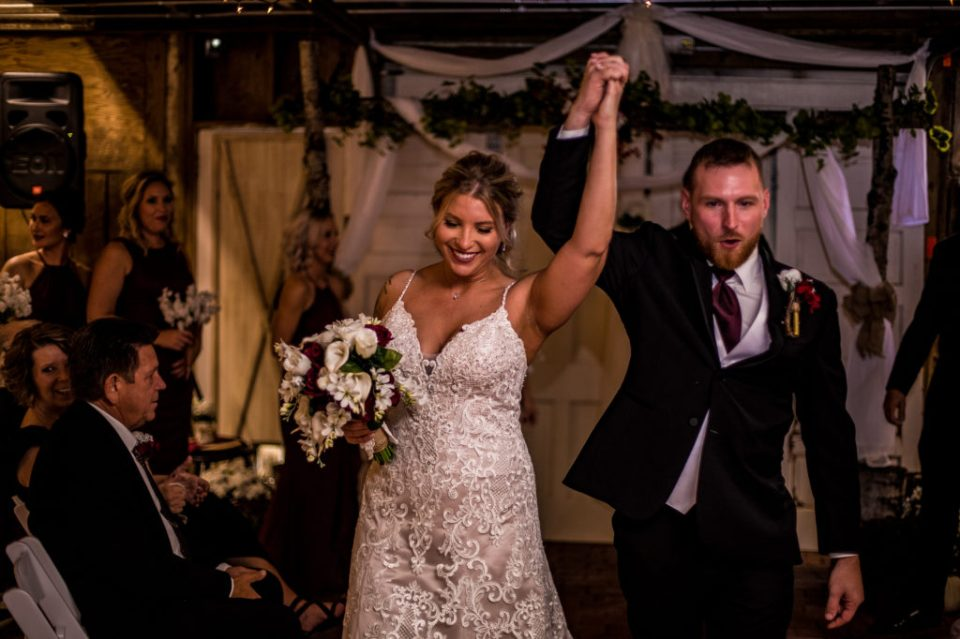 Bride and groom exit their Barn at Conneaut Creek wedding ceremony
