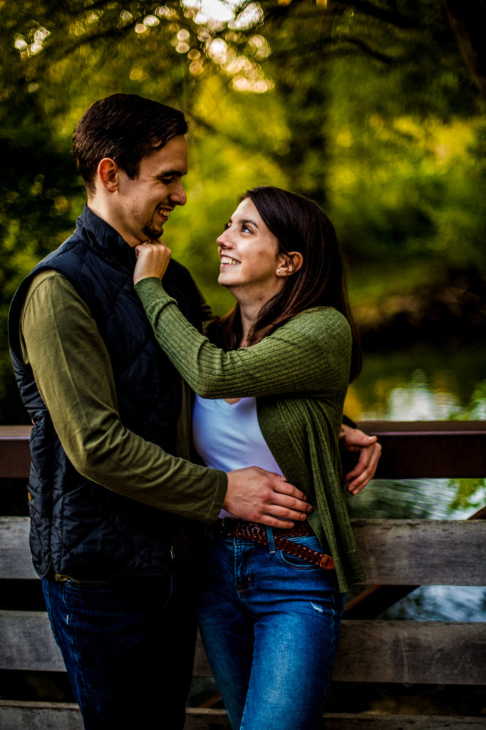 Woman pinches fiance's chin during engagement photos at Frontier Park in Erie, PA