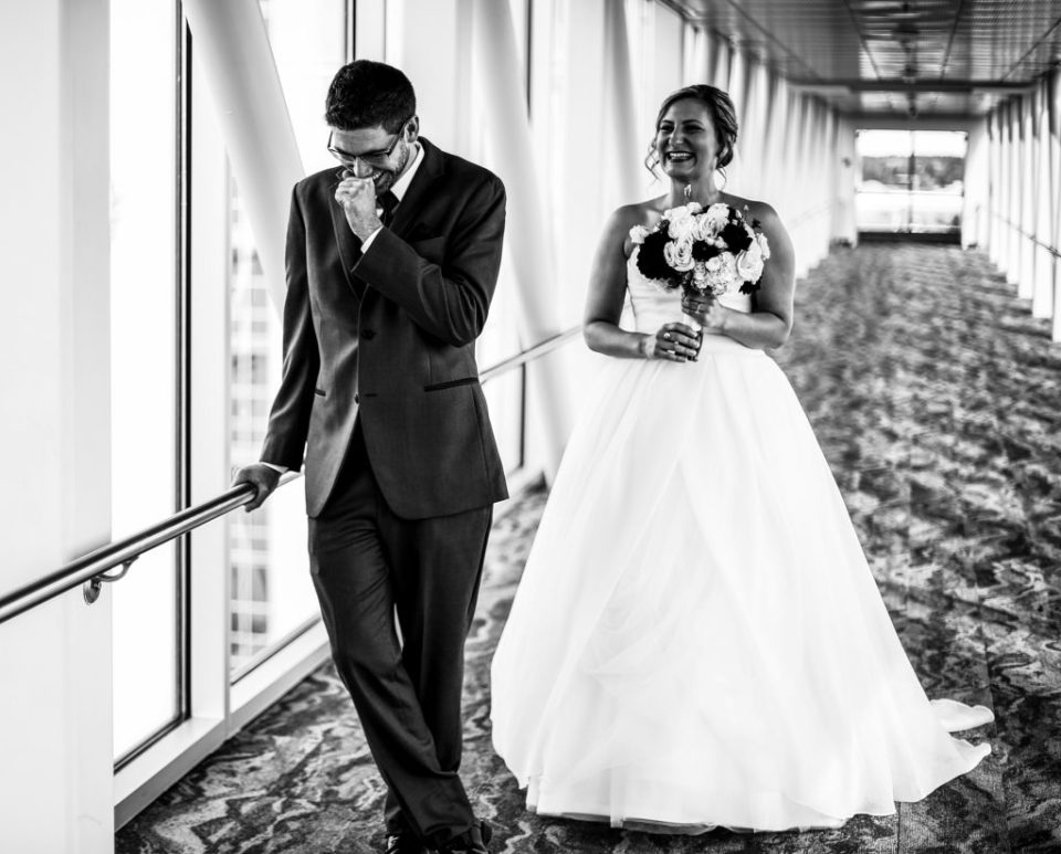 Bride apporaches groom for first look at Sheraton Erie Bayfront Hotel wedding