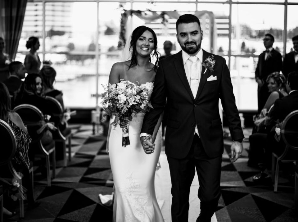 Recessional portrait of bride and groom at Sheraton Erie Bayfront Hotel
