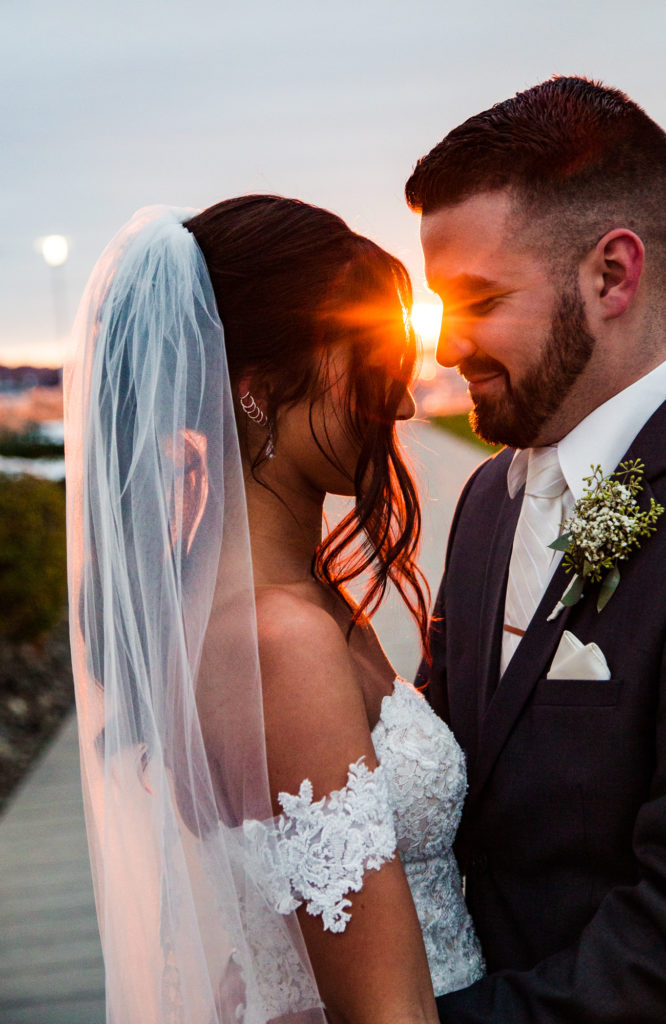 Bride and groom frame the light of sunset in downtown Erie wedding