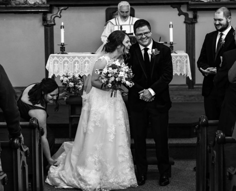 Bride and groom laughing at the end of their wedding ceremony