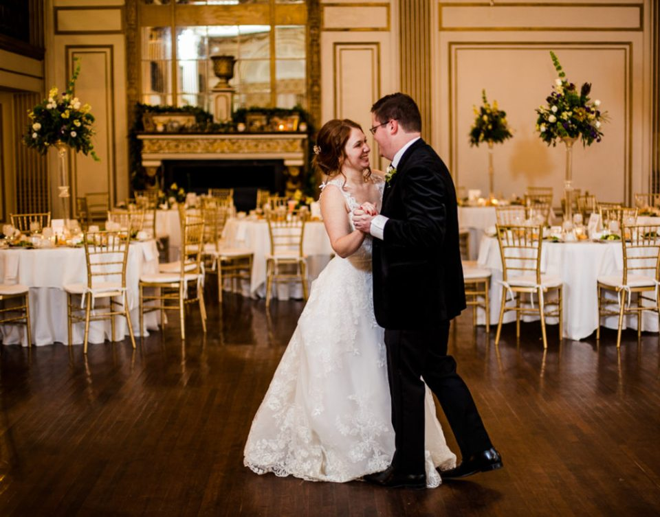 Bride and groom practice first dance in Grand Ballroom of the George Washington Hotel