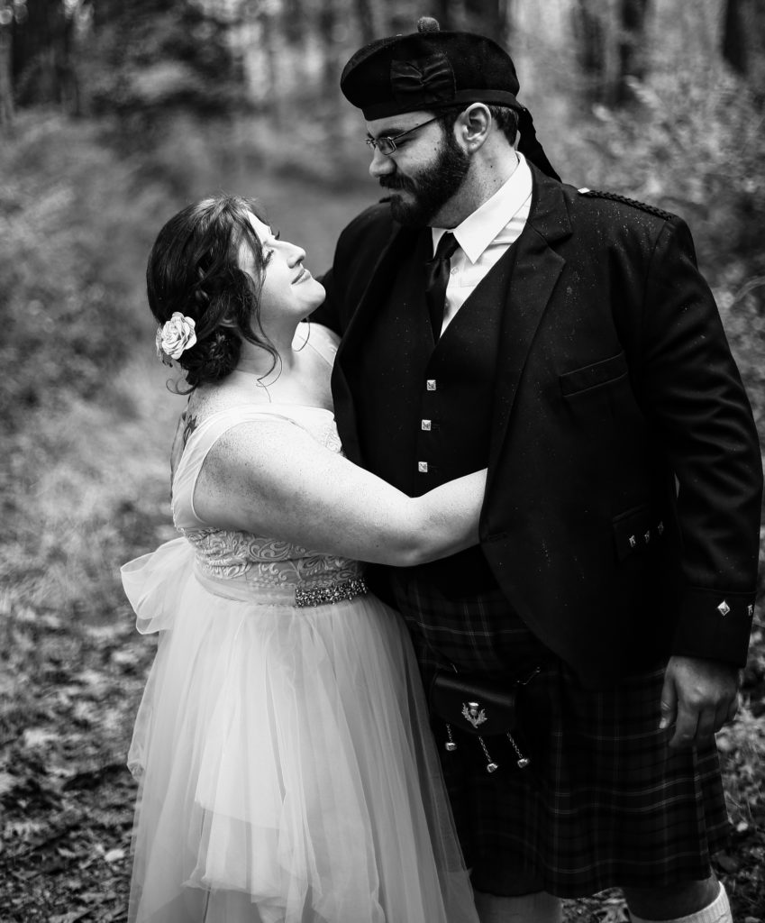 Bride and groom embrace at Bushy Run Battlefield