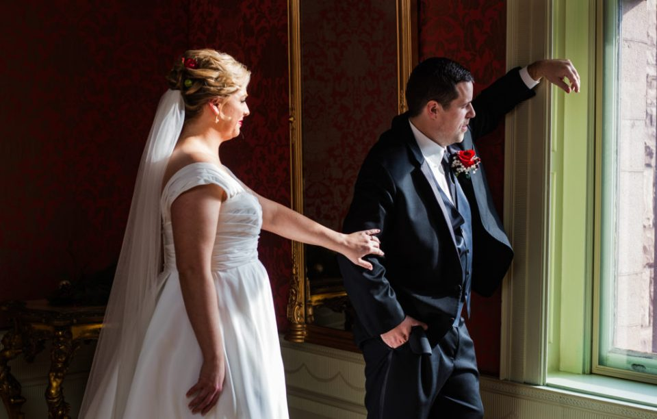 Bride gets groom's attention for first look at wedding at Watson Curtze Mansion in Erie, PA