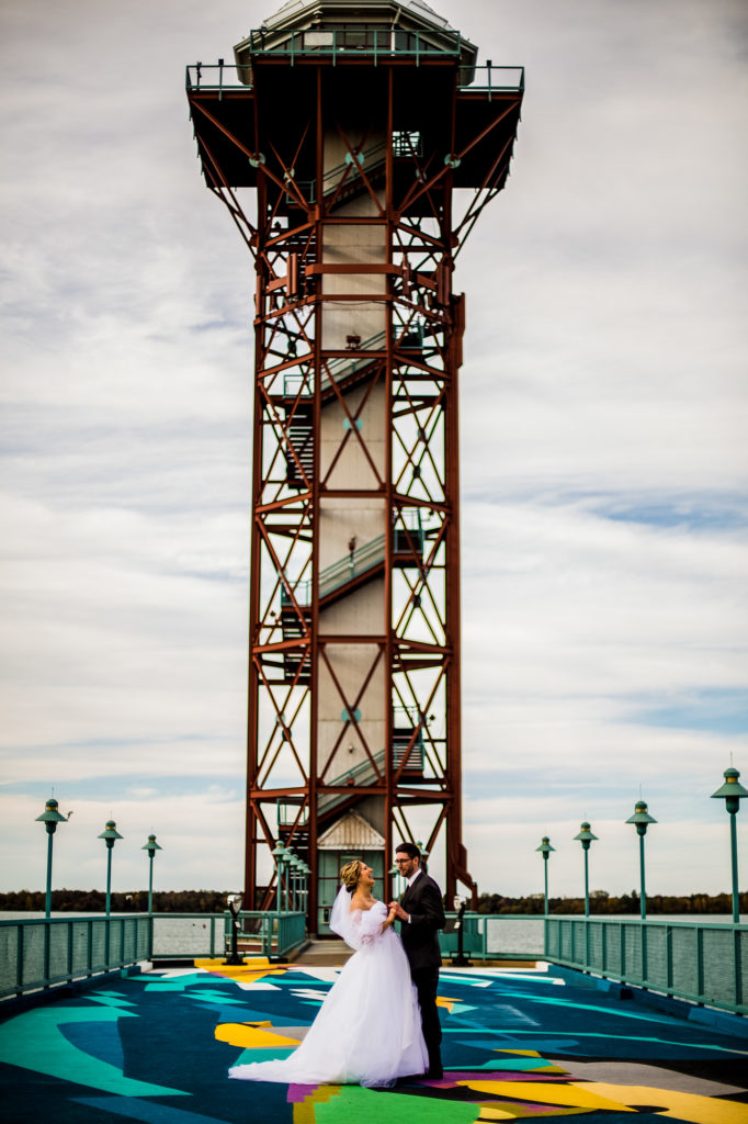 Bride and groom in front of Erie, PA's Bicentennial Tower on Dobbin's Landing