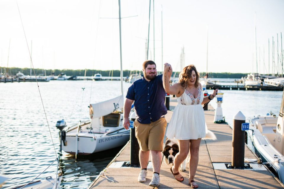 Couple dances on dock at the Erie Yacht Club during engagement photos in Erie PA