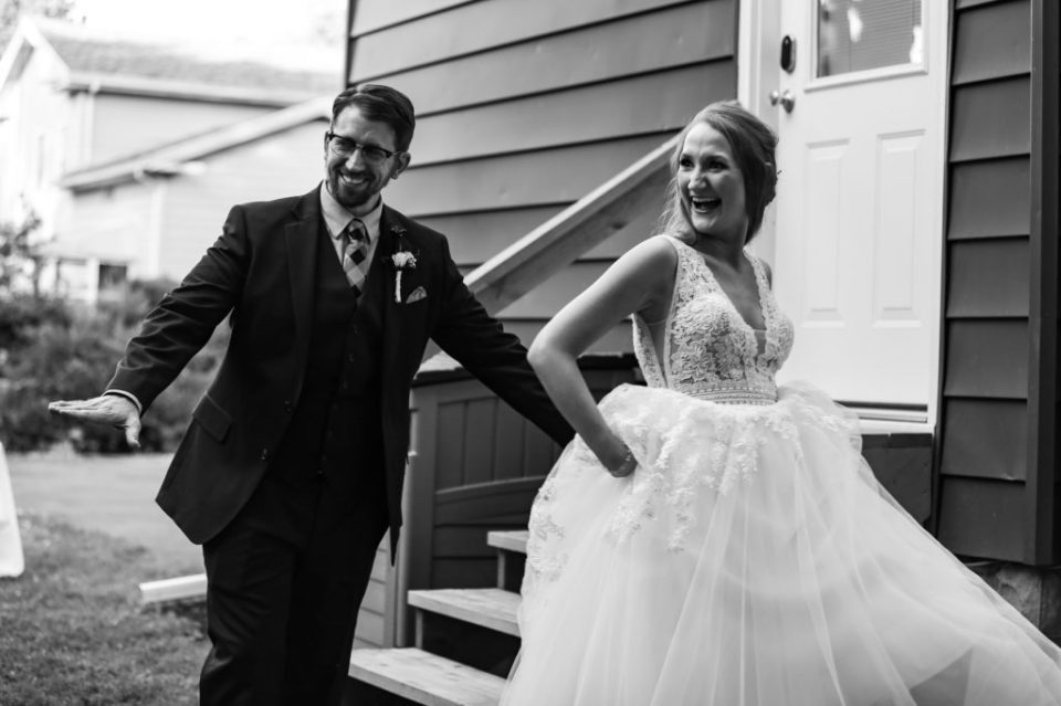 Laughing couple at their intimate backyard wedding