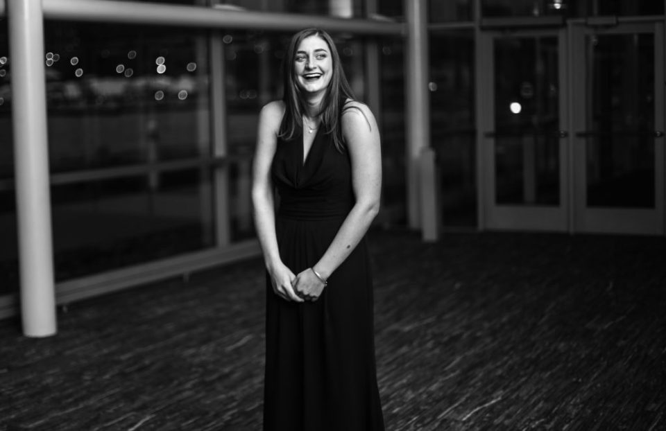 Woman in a black dress laughing
