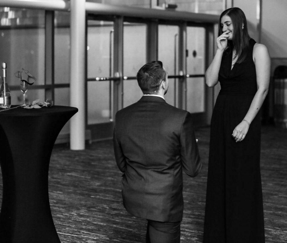 Man on one knee proposing to his girlfriend at Bayfront Convention Center in Erie PA