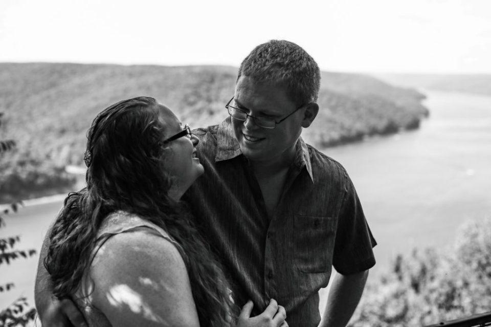 Smiling couple standing at scenic overlook in Warren PA