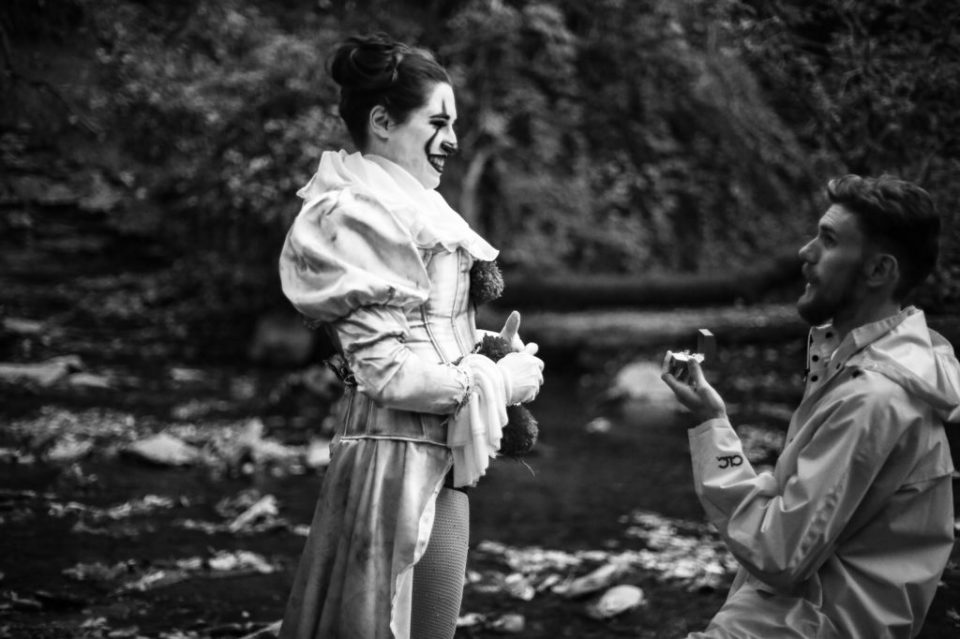 Man proposes to woman for Halloween engagement photo session