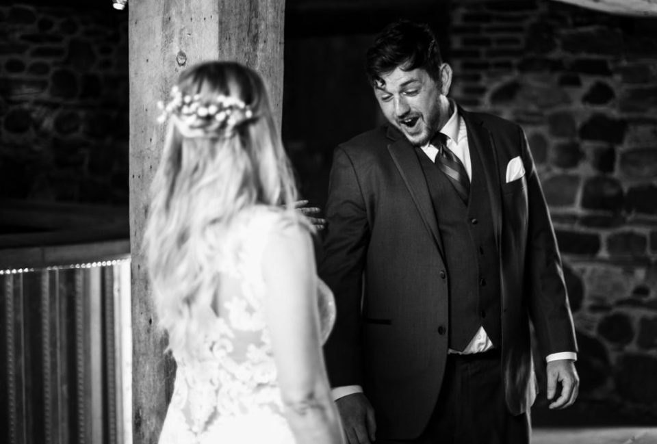 "Groom saying ""WOW"" when he sees bride during first look photos at Quincy Cellars"