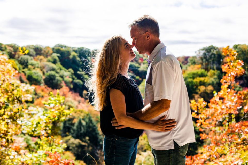 Couple smiling at each other stand nose to nose at Wintergreen Gorge in Erie, PA