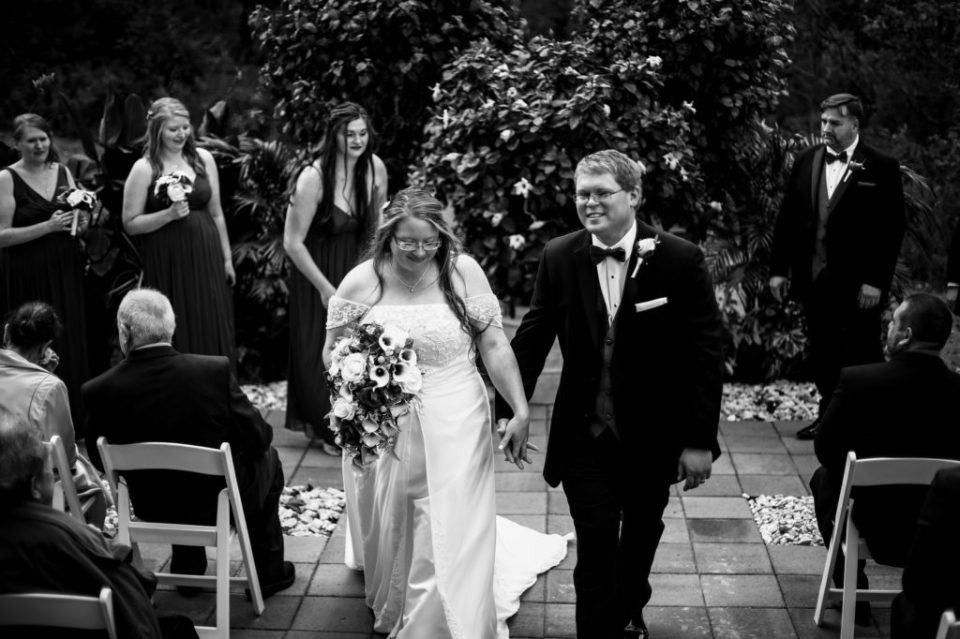 Recessional portrait of couple at their intimate wedding at home in Erie PA
