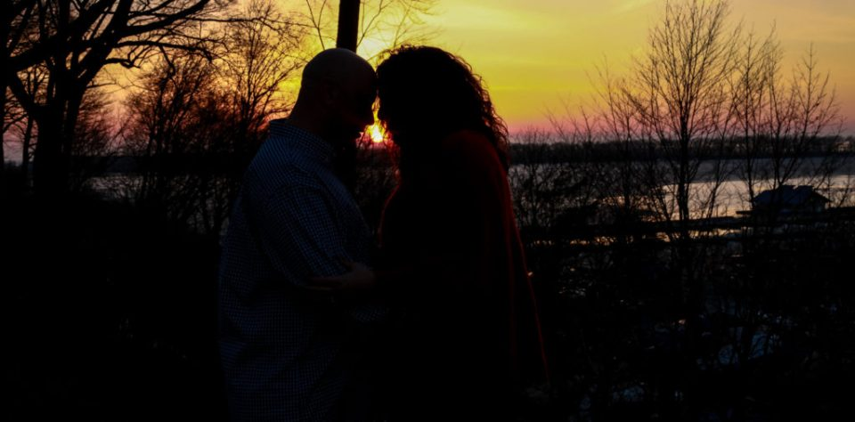 Silhouette of couple at sunset on the foot of Lincoln Avenue in Erie, PA