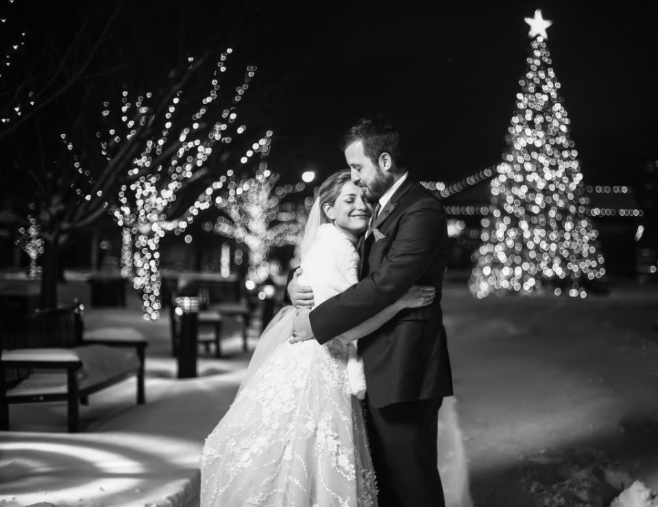 Bride and groom embrace in Perry Square on the day after Christmas
