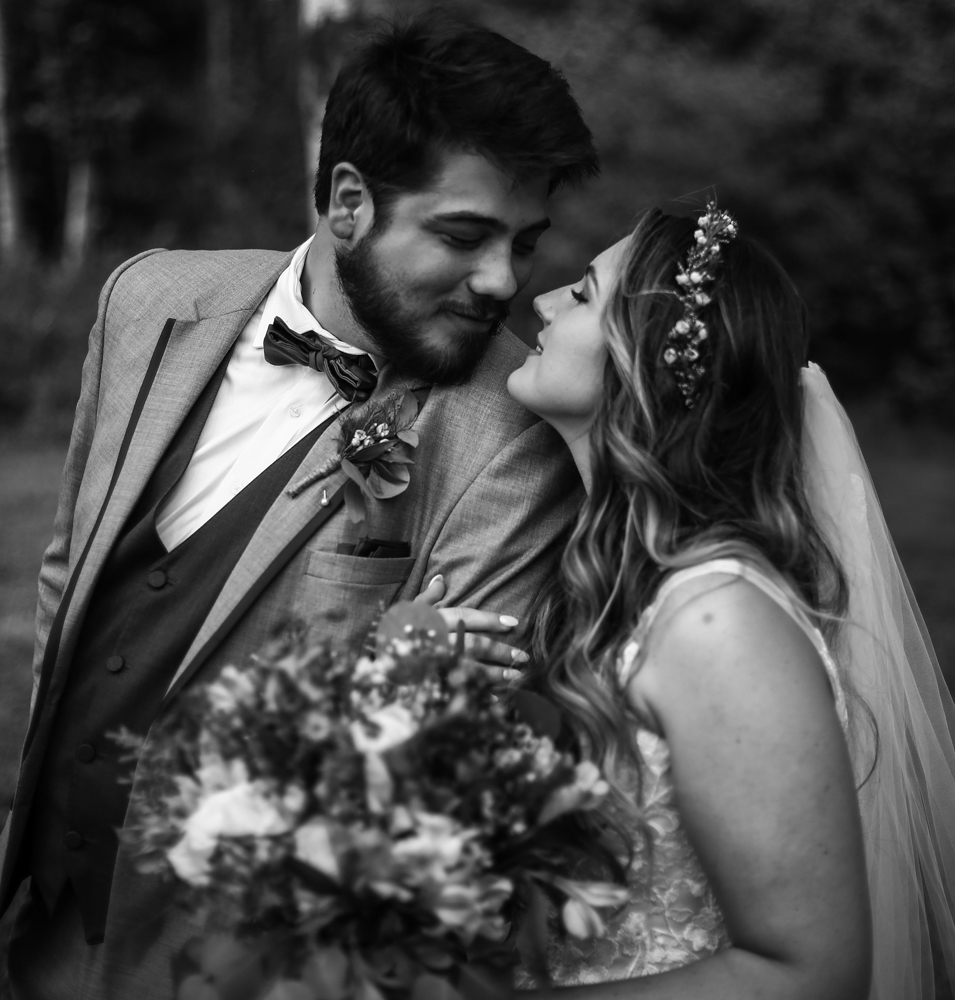 Bride and groom smiling at each other during Whispering Trees Manor wedding
