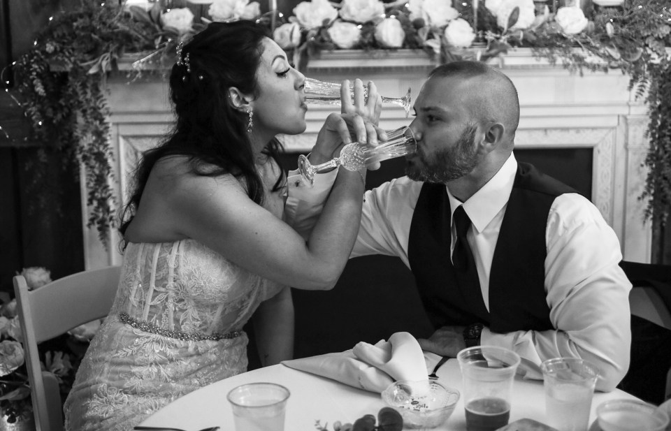 Couple drinking champagne with interlaced arms at their wedding at Port farms