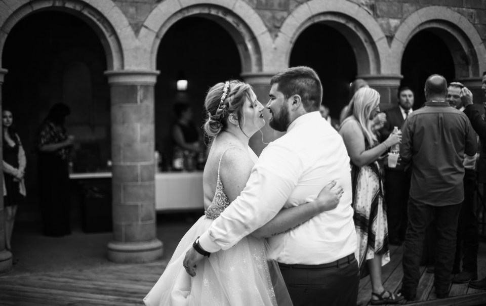 Couple shares first dance in the courtyard at Beach Glass Estates wedding